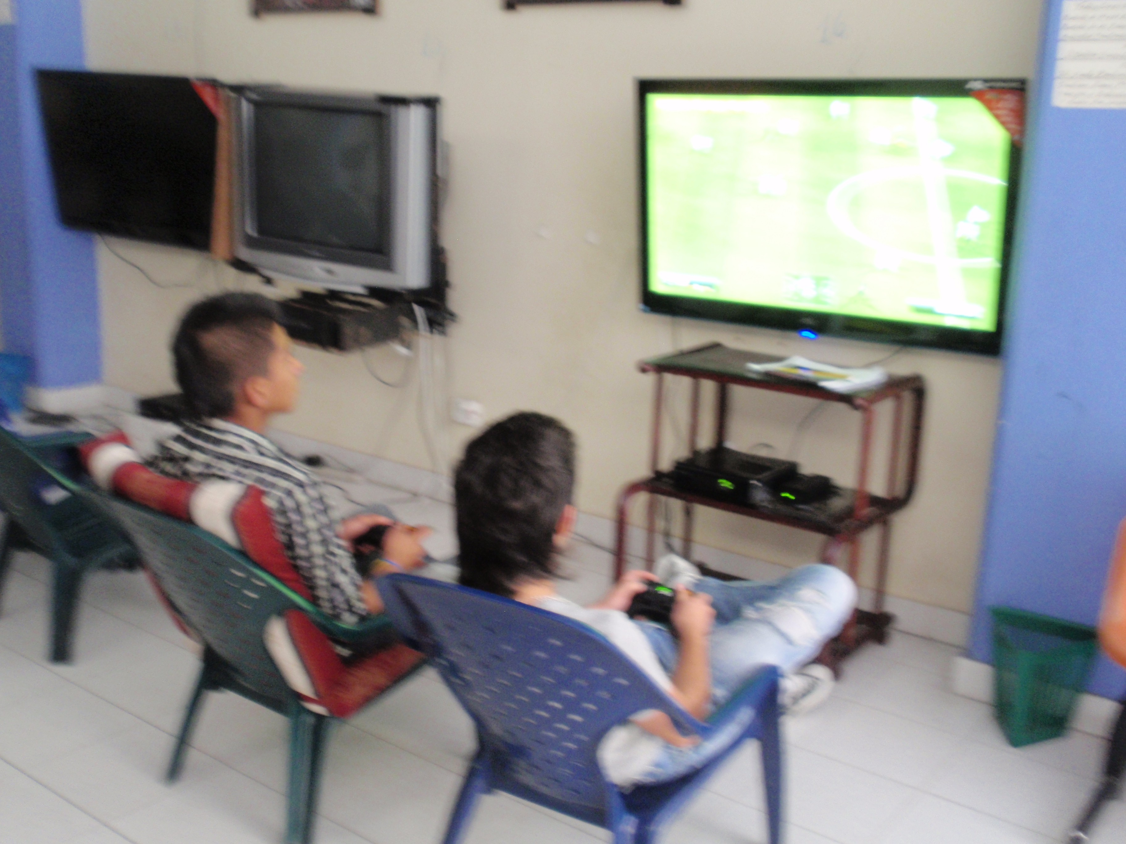 Internet cafe, Colombia two kids playing FIFA